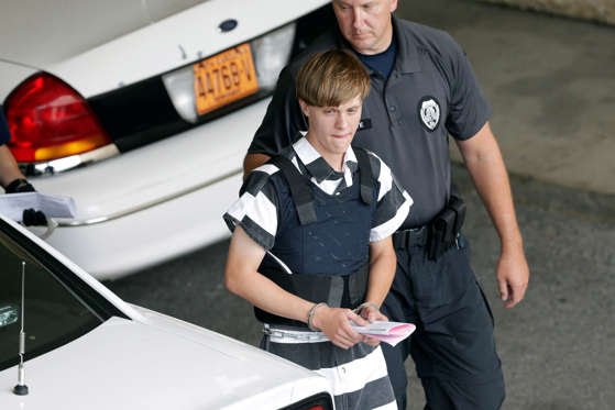 Charleston, South Carolina, shooting suspect Dylann Storm Roof is escorted from the Cleveland County Courthouse in Shelby, North Carolina, on Thursday, June 18, 2015. Roof is a suspect in the shooting of several people Wednesday night at the historic The Emanuel African Methodist Episcopal Church in Charleston. Chuck Burton/AP