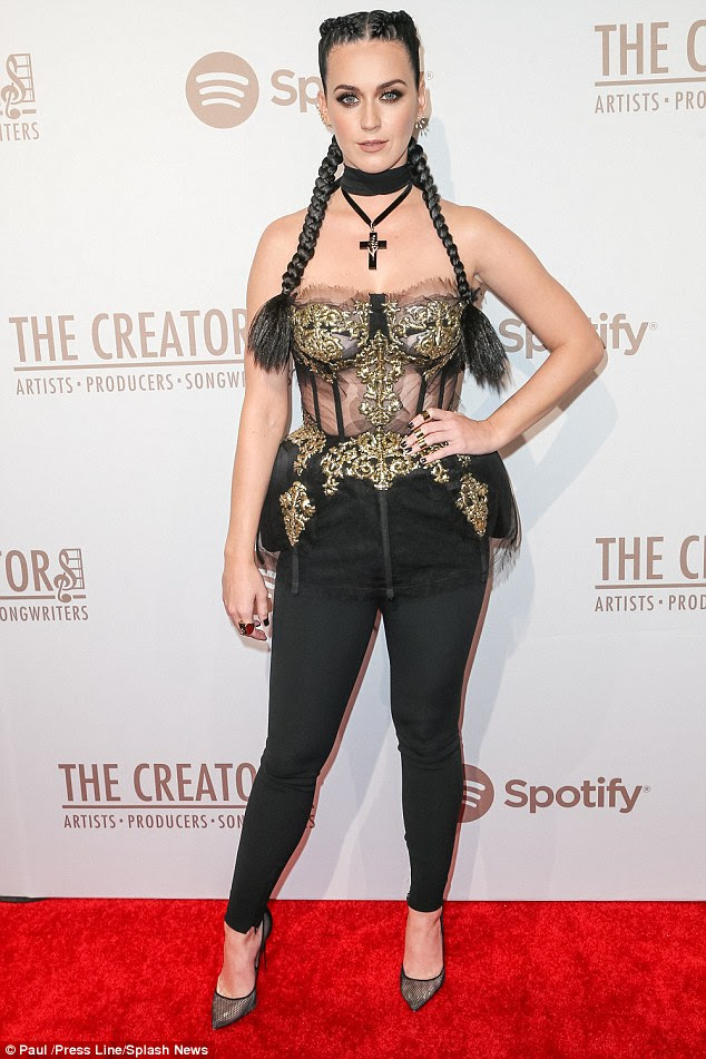 Interesting look: Katy Perry wore a see-through corset with strategically placed gold embellishments for a pre-Grammys party she hosted in downtown Los Angeles on Saturday night