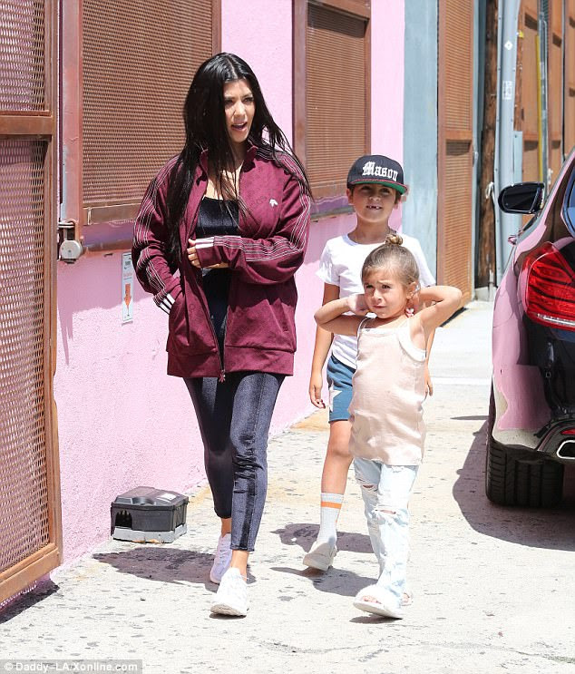 Family affair: Kourtney, 38, brought along her two eldest kids - Mason, seven, and Penelope, four. Their father is her estranged partner Scott Disick