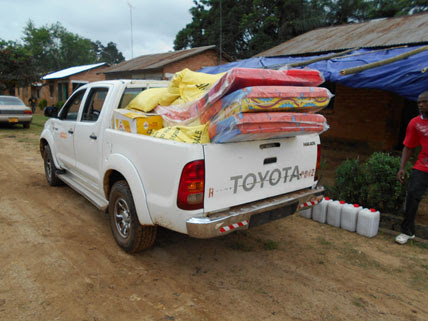 Truck transporting solidarity kits containing essential supplies for Ebola survivors returning home - Firestone District, Liberia, 2014