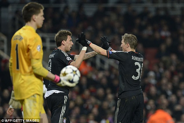 It's all over: Schweinsteiger congratulates Mandzukic (centre) after his goal sealed victory