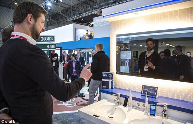 The connected mirror, pictured, is a concept designed by Oral B.The firm added a motion sensor to a sink and when a person waves their hand in front of it, the interactive mirror is enabled. By swiping their hand up or down, users can scroll through a menu in the same way they would on a smartphone