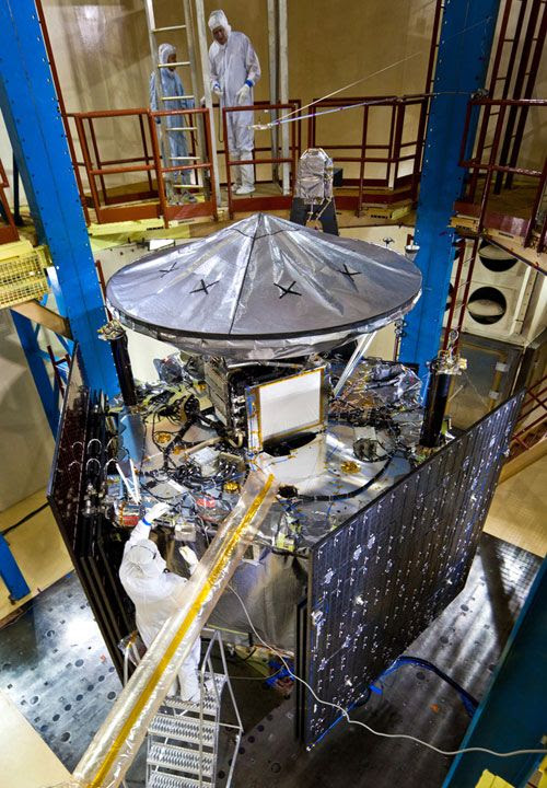Engineers work on NASA's Juno spacecraft at the Lockheed Martin facility in Denver, Colorado, on January 26, 2011.