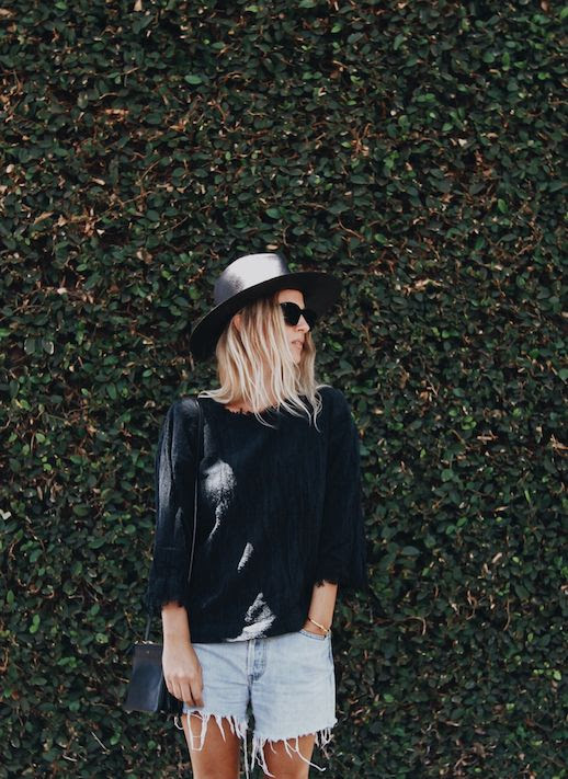 Le Fashion Blog Black Straw Hat Black Raw Hem Sweater Denim Cut Offs Via Mijaflatau