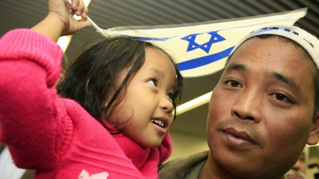 Newly arrived Bnei Menashe immigrants at Ben Gurion airport in 2006 (photo credit: Nati Shohat/Flash90)