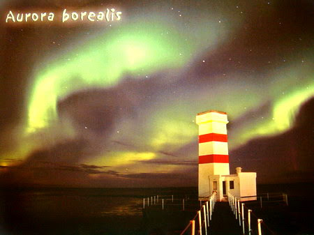 Northern lights spread above Gardskagi lighthouse, Southwest Iceland