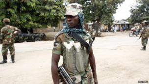 Congolese M23 rebels stand on a street in Rutshuru, Democratic Republic of Congo 3 August, 2013.