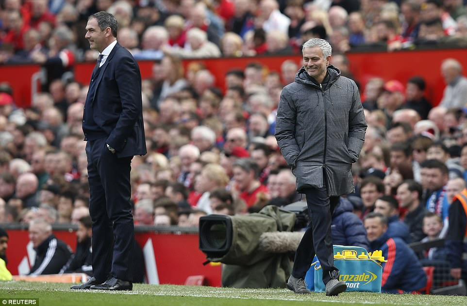 The United boss wears a wry smile as he makes his way down the tunnel before the half-time whistle sounds