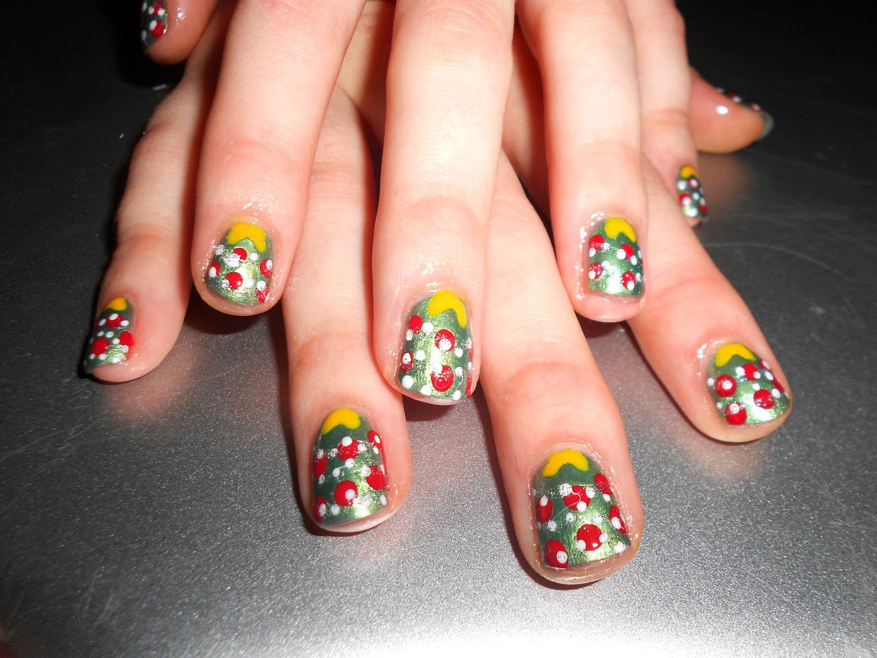 Kelesea's Christmas nails this week. They aren't the greatest but they're still cute.