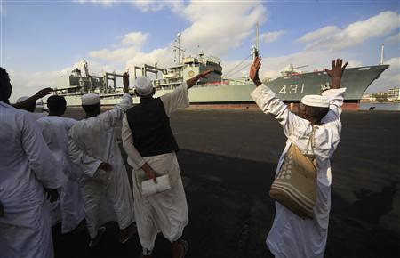Sudanese waving at Iranian warship as it leaves the country. The two nations are under attack by US imperialism and Israel. by Pan-African News Wire File Photos