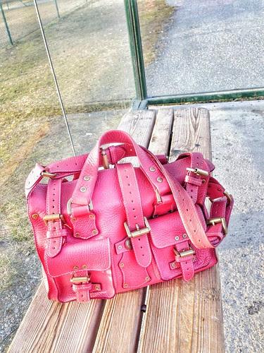 dusting off a pink ol' handbag