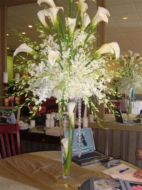 calla lillie and orchid centerpiece   Calla lilies and/or