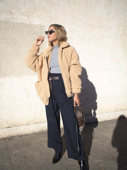 Le Fashion Blog Casual Chic Blogger Outfit Cat Eye Black Sunglasses Beige Teddy Coat Grey Mockneck Sweater Navy Paper Bag Waist Wide Leg Pants Black Low Heel Booties Via Unconscious Style