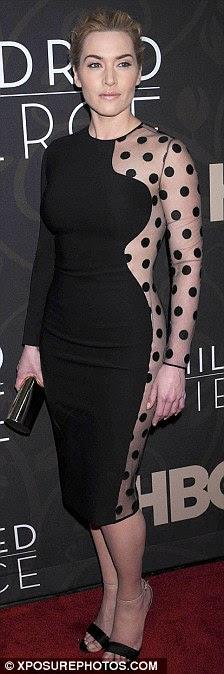 Parece familiar?  Vestido de Amy, de sua linha de roupa própria, carrega uma semelhança impressionante ao design Stella McCartney é celebridade favorita, usado aqui em março por Kate Winslet