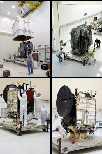 Technicians remove Dawn from its crate and protective cover to begin final launch preparations.