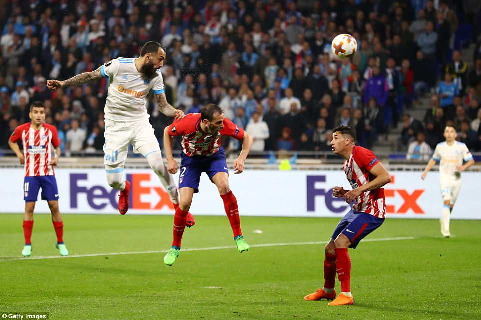Kostas Mitroglou comes close to getting Marseille back in the game after sending his header crashing against the post