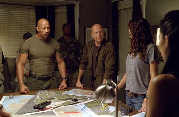 Roadblock (Dwayne Johnson), General Joseph Colton (Bruce Willis), Lady Jaye (Adrianne Palicki) and Jinx (Elodie Yung, far right) devise a plan to defeat Cobra in G.I. JOE: RETALIATION.