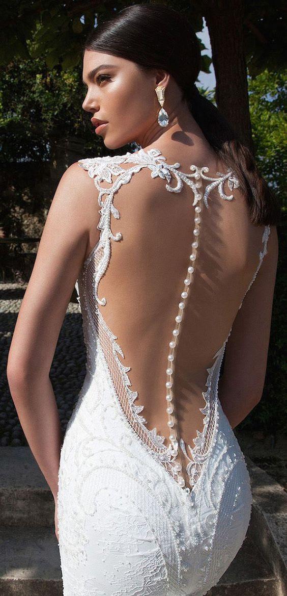 Meerjungfrau Hochzeitskleid mit illusion zurück, und eine Reihe von Schaltflächen, um es zu markieren