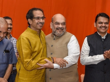 File image of Shiv Sena chief Uddhav Thackeray, Home Minister Amit Shah, and former Maharashtra CM Devendra Fadnavis. PTI