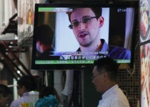 Edward Snowden on a TV screen in Hong Kong (Kin Cheung/AP)