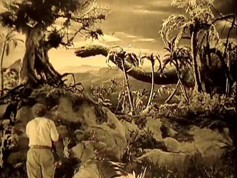 In the foreground, humans.  In the background, dinosaurs, from the 1925 Lost World.