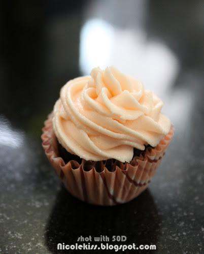 orange icing on mini cupcake