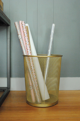 gold spray paint DIY trash can wrapping paper organizer holder