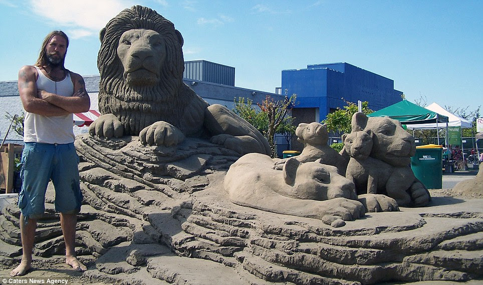 Roaring success: Brit Paul and his Dutch wife Remy compete in both singles and doubles competitions for sand sculpting