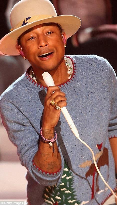 Participaram: as super estrelas globais Pharrell Williams (L) e Usher (R) foram adicionadas ao line-up para o programa One Love - realizaram apenas duas semanas após o atentado suicida, que deixou 22 mortos