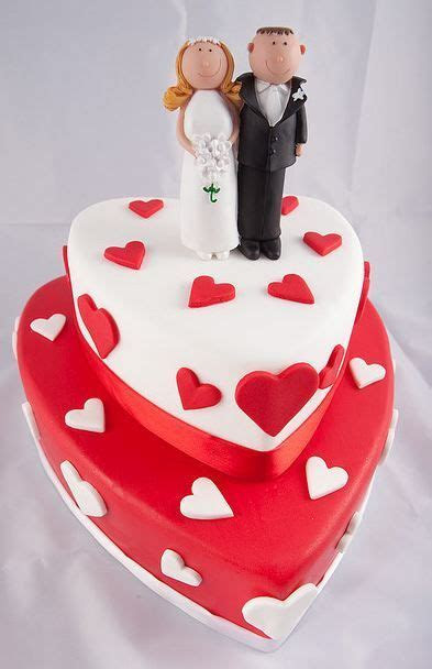 Two tier heart shaped wedding cake in white and red with