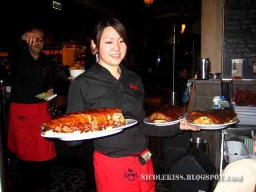 waitress with giant pork ribs