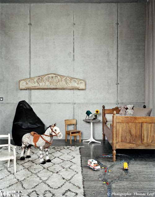 The dominance of concrete makes this child's room unusual. We love how the wooden furniture warms the space up. From 'Rock Star', a story on page 182 of Vogue Living May/June 2011. Photograph by Thomas Loof.