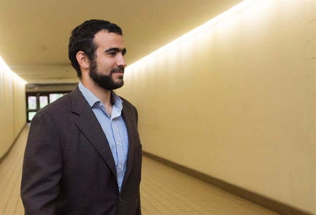 Omar Khadr leaves court after a judge ruled to relax bail conditions in Edmonton on Sept. 18, 2015. The federal government has paid former Guantanamo Bay inmate Omar Khadr $10.5 million as part of a deal to settle his long-standing lawsuit over violations of his rights, The Canadian Press has learned.Speaking strictly on condition of anonymity, a source familiar with the situation said the Liberal government wanted to get ahead of an attempt by two Americans to enforce a massive U.S. court award against Khadr in Canadian court. THE CANADIAN PRESS/Amber Bracken