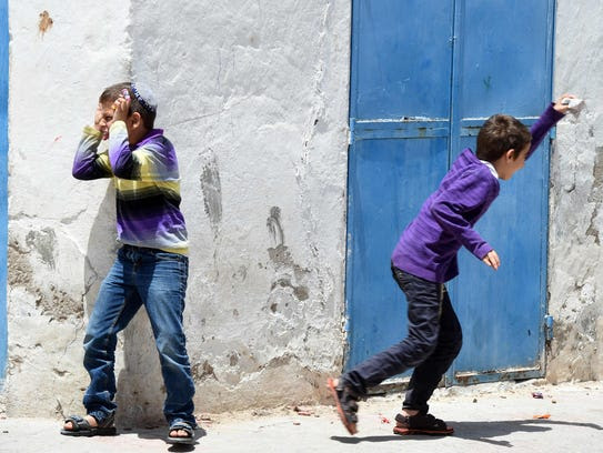 Tunisian Jewish youths play in the streets of Hara