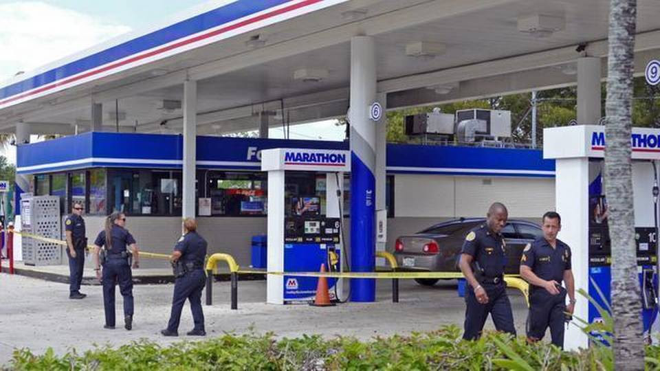 Miami police work a shooting scene at the Marathon Gas Station at Southwest 37th Avenue and 16th Street on Monday, March 30, 2015.