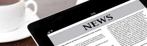 Tablet displaying news