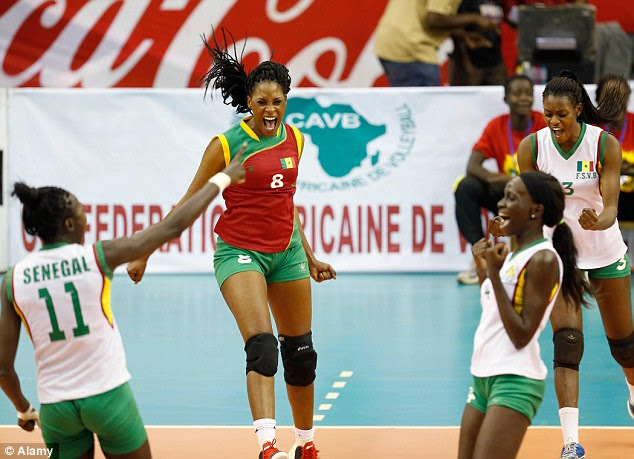 Sports star: Diallo Awa, second left, celebrates scoring with her teammates during the 2014 FIVB Women's Volleyball World Championship Qualifiers between Senegal and Seychelles in Nairobi