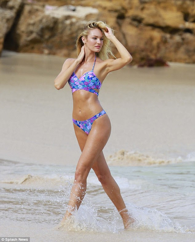 Flawless! Candice Swanepoel, 27, spent Sunday splashing around on the Caribbean island of St. Barth