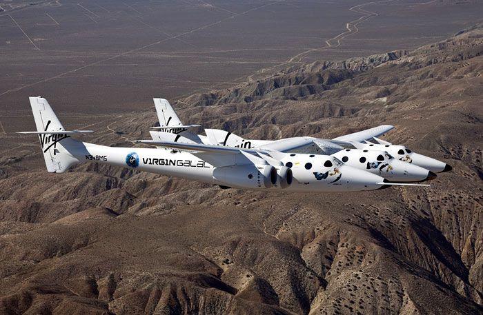 The VMS Eve and VSS Enterprise soar above California's Mojave Desert.