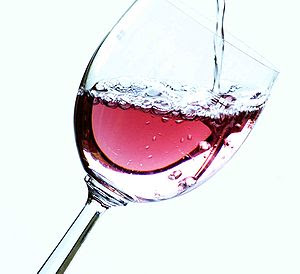 A glass being full of rosé wine