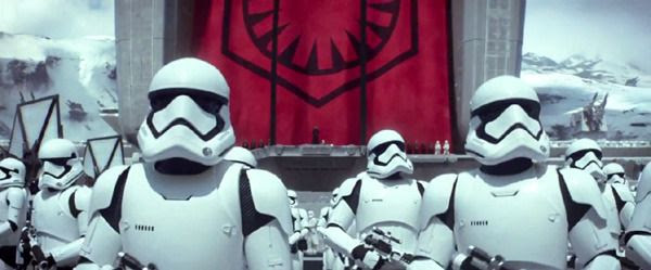 Stormtroopers of The First Order turn to get into formation in STAR WARS: THE FORCE AWAKENS.
