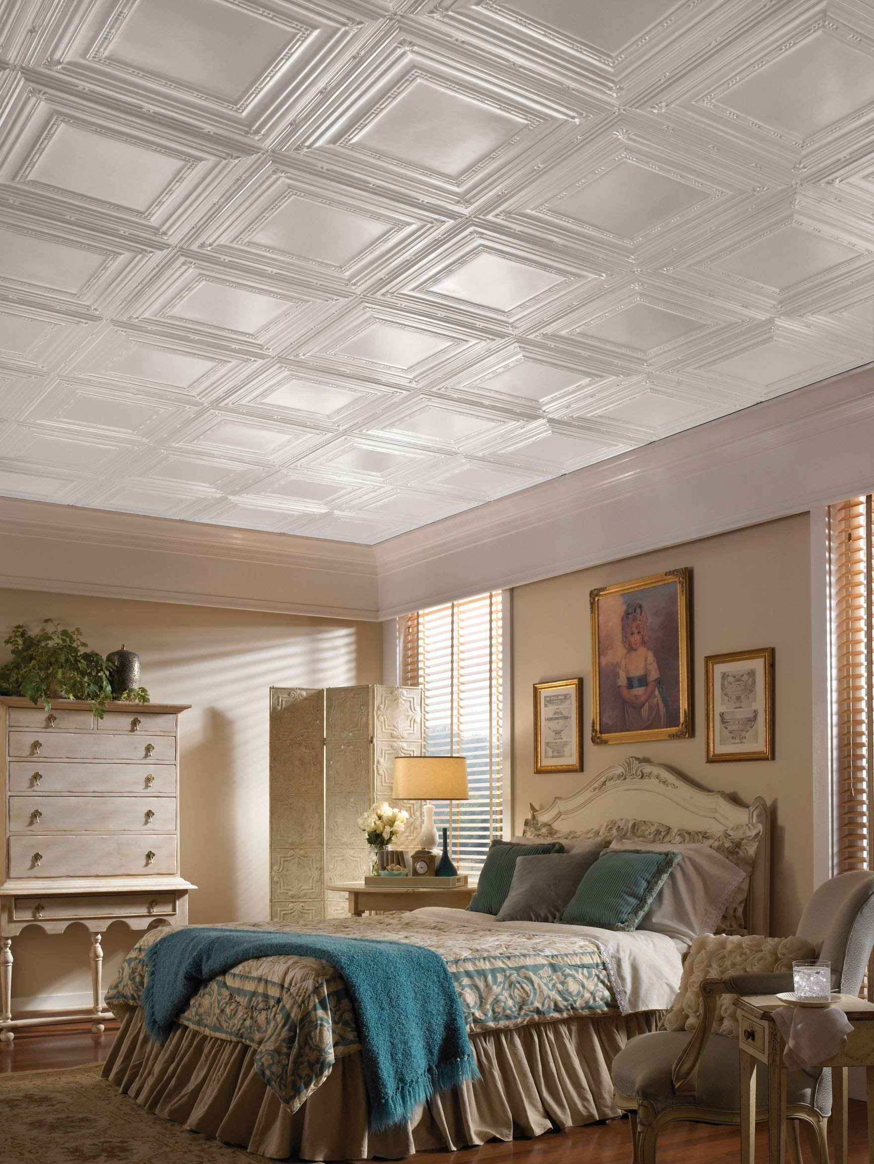 a neutral bedroom with coffered ceiling panels