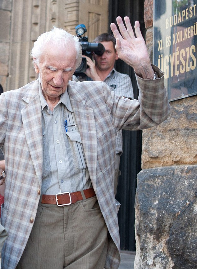 Manhunt: The 97-year-old arrested and questioned by Budapest police. He is accused of orchestrating the murder of 15,700 Jewish Hungarians