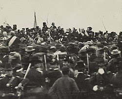 The only confirmed photo of Abraham Lincoln at Gettysburg (seated), taken about noon, just after Lincoln arrived and some three hours before he spoke. To Lincoln's right is his bodyguard, Ward Hill Lamon.