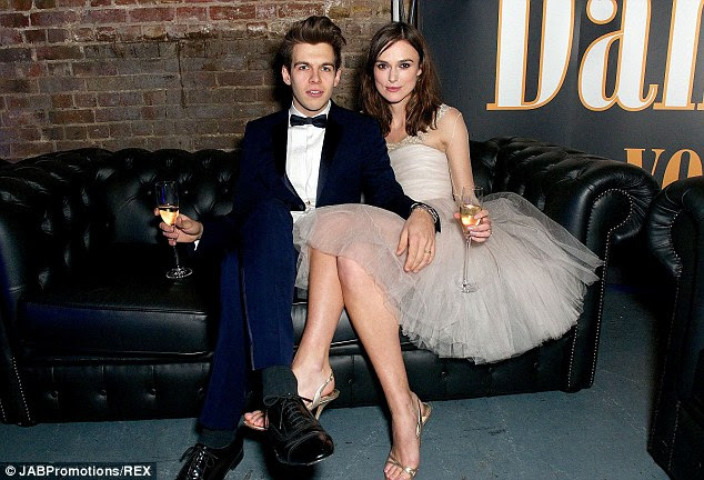 Me and my man: The gorgeous couple cosied up on a sofa as they sipped champagne at the charity do