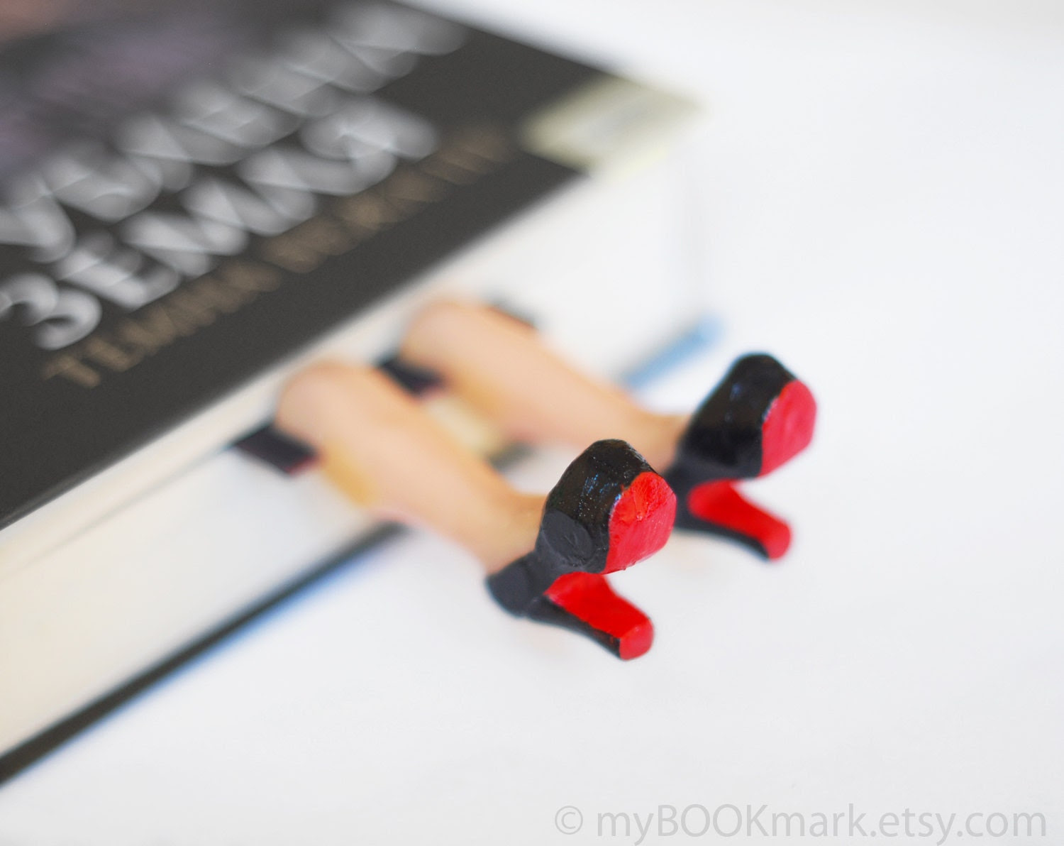 Legs in the book. Louboutin shoes. Elegant high fashion gift. Black and red. Desk accessory for her. ohtteam - MyBookmark