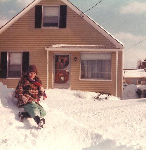 Linda on top of snowplow pile