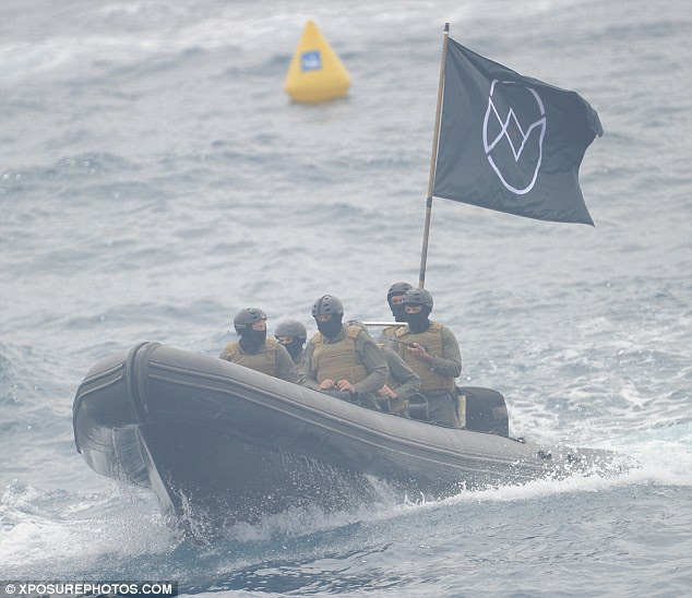 The military-style men raced up to the Hotel du Cap Eden-Roc, 30 minutes outside Cannes in a high-speed boat