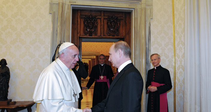 Russian President Vladimir Putin, right, during his meeting with Pope Francis in the Apostolic Palace of the Vatican, November 25, 2013