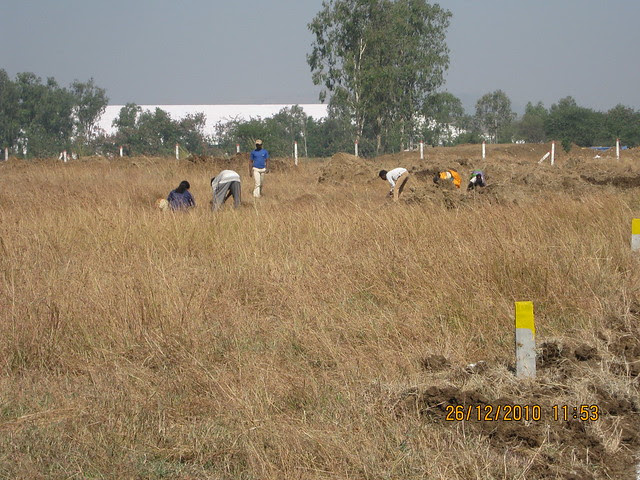 Marking the plots at Majestic  NA Bungalow Plots:  at Kanhe Phata - near Vadgaon - Talegaon, walking distance from Kanhe Railway Station, on Old Mumbai Pune Highway (NH 4)
